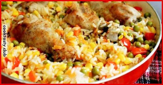Ароматная курица с гарниром из риса и овощей по-каталонски